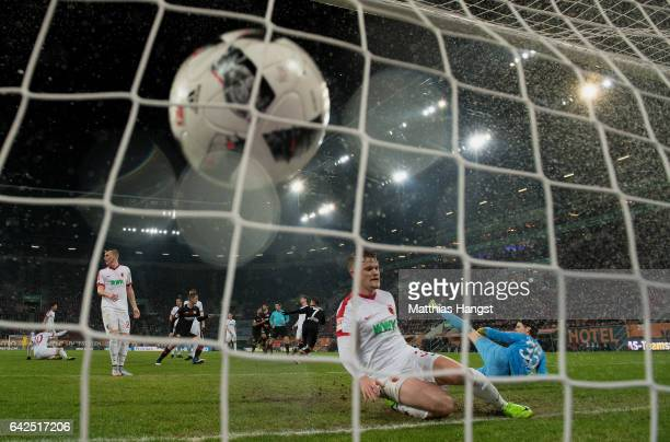 Chicharito of Leverkusen scores his team's second goal past Goalkeeper Marwin Hitz of Augsburg during the Bundesliga match between FC Augsburg and...