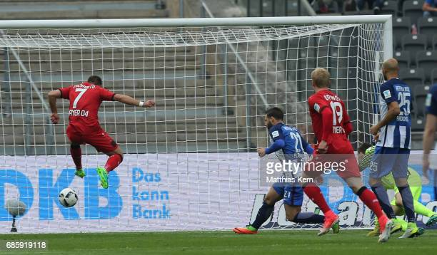 Chicharito of Leverkusen scores the first goal during the Bundesliga match between Hertha BSC and Bayer 04 Leverkusen at Olympiastadion on May 20...