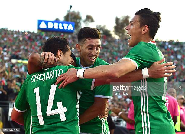 Chicharito of Mexico celebrates his goal with Hector Herrera and Hector Moreno to take a 10 lead over Jamaica during Copa America Centenario at Rose...