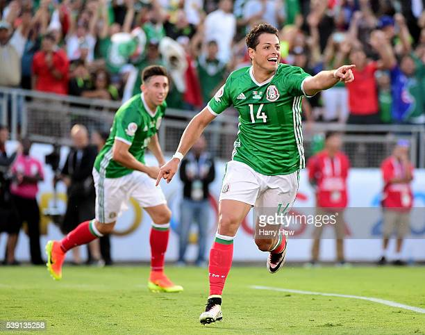 Chicharito of Mexico reacts after his goal with Hector Herrera to take a 10 lead over Jamaica at Rose Bowl during Copa America Centenario at the Rose...