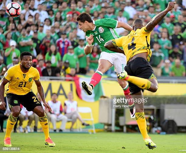 Chicharito of Mexico scores on a header between Wes Morgan and Jermaine Taylor of Jamaica to take a 10 lead during Copa America Centenario at Rose...