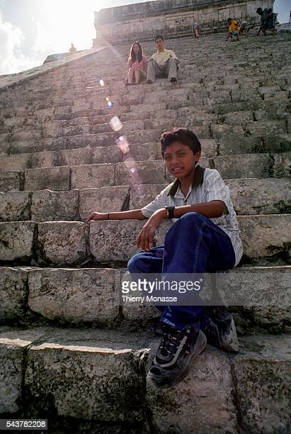 Chichén Itzá Yucatán State Mexico December 22 2004 A child is waiting on the Temple of Kukulcan that is a Mesoamerican steppyramid that dominates the...