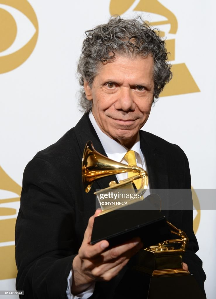 Chick Corea poses with his trophies in the press room at the Staples Center during the 55th Grammy Awards in Los Angeles, California, February 10, 2013. AFP PHOTO Robyn BECK