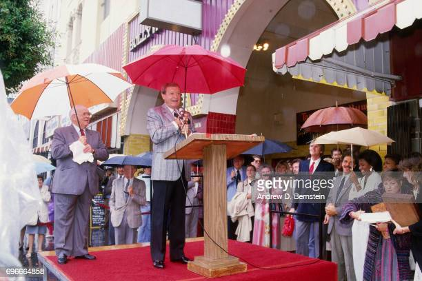 Chick Hearn of the Los Angeles Lakers has his wall of fame unveiling circa 1987 in Los Angeles California NOTE TO USER User expressly acknowledges...