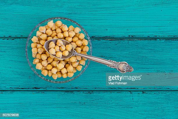 Chick peas on a wood background