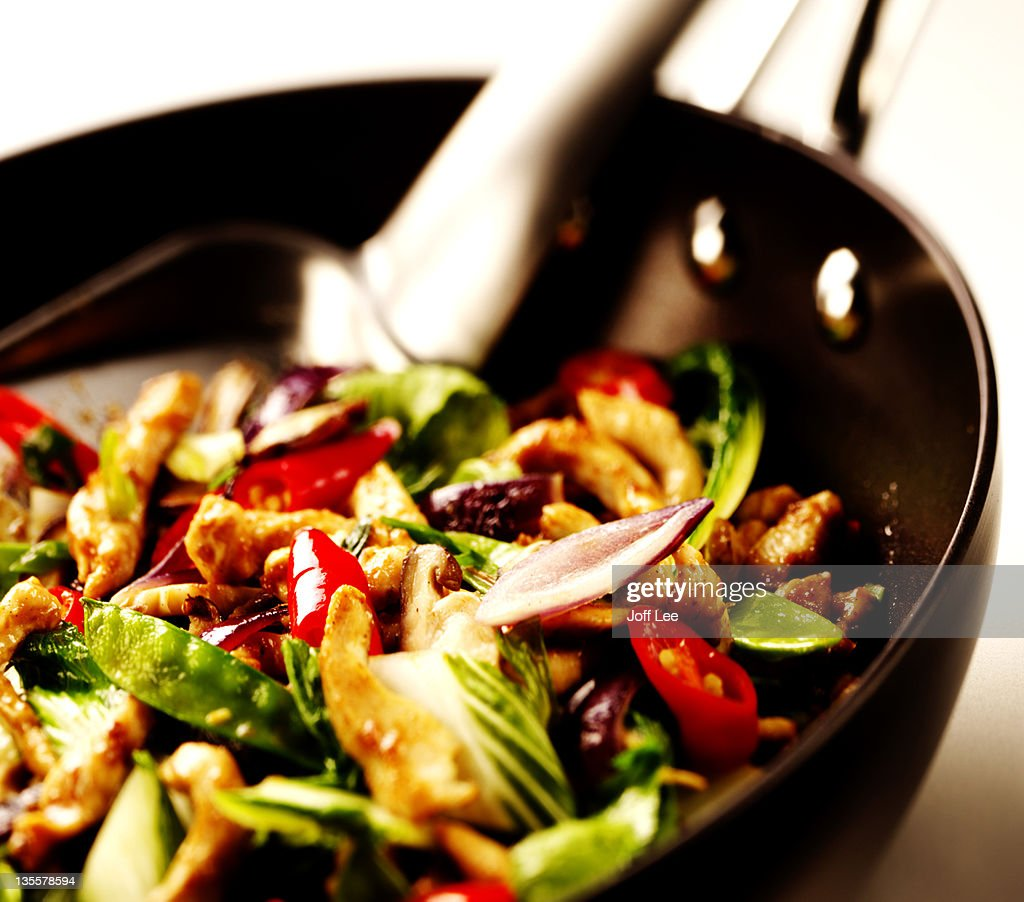 Chicken and vegetable stirfry in wok : Stock Photo