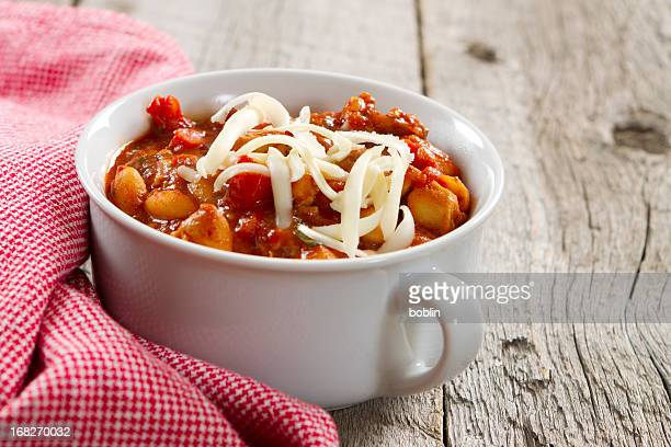 Chicken and white bean chili with a plaid red napkin
