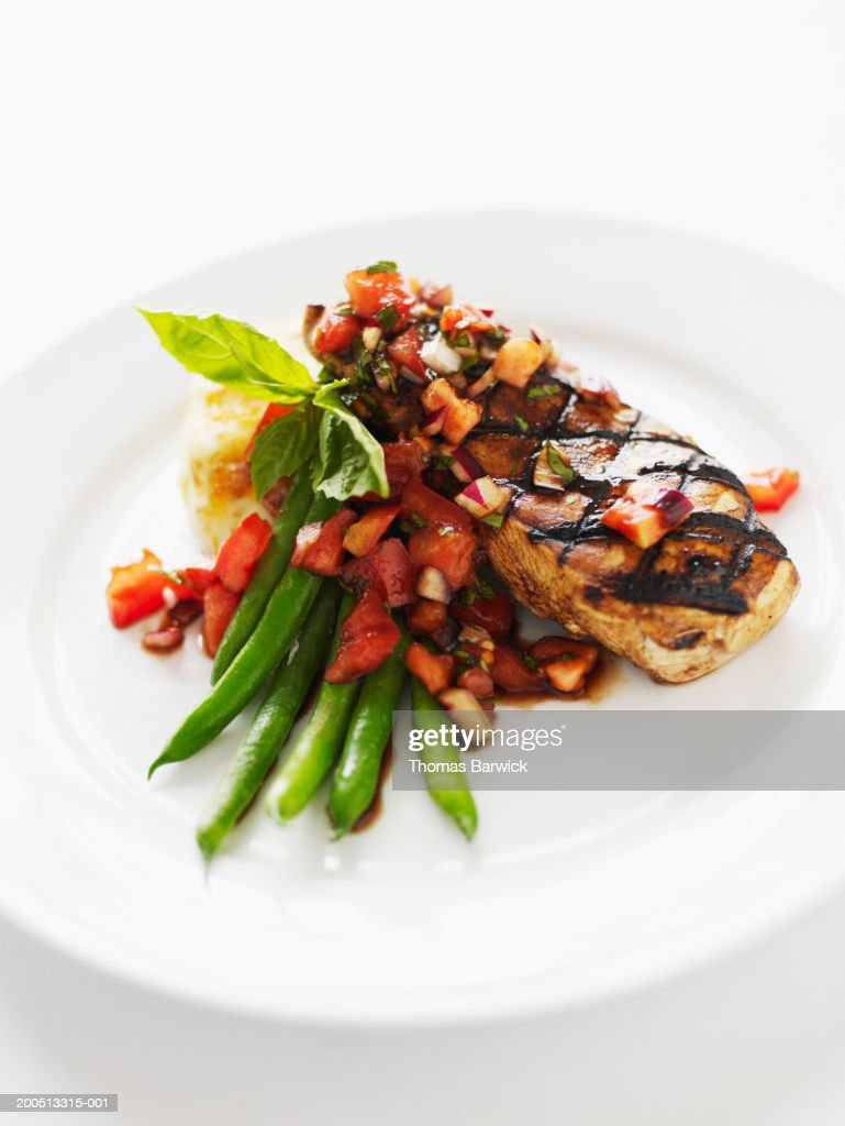 Chicken breast with green beans, heirloom tomatoes and potato cake : Stock Photo
