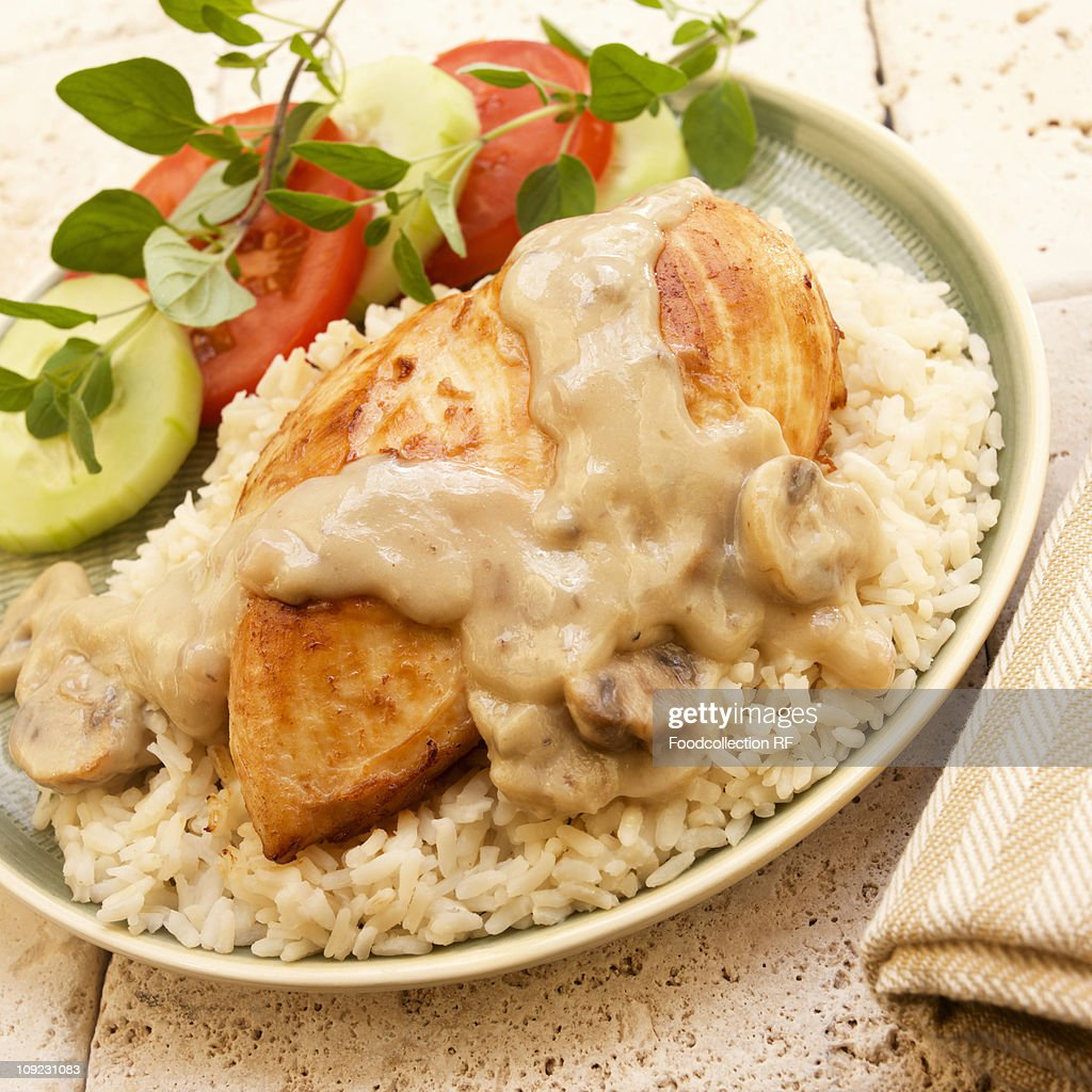 Chicken breast with mushroom sauce and rice, close-up : Stock Photo