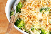 Chicken broccoli casserole with buttered breadcrumbs and grated cheese