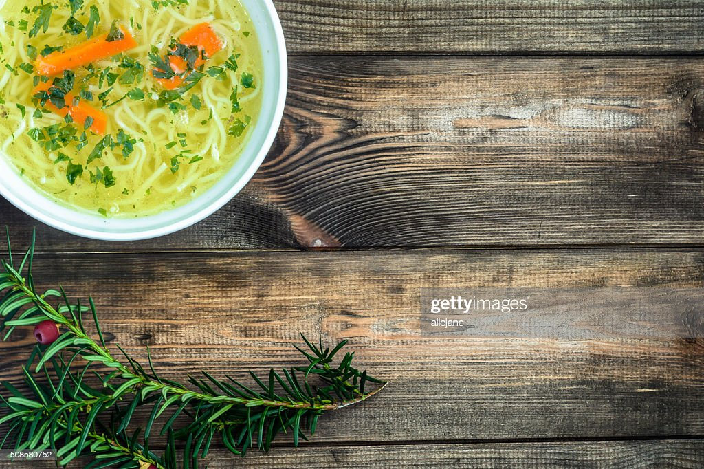 Chicken broth soup with noodles on a wooden table. : Stockfoto