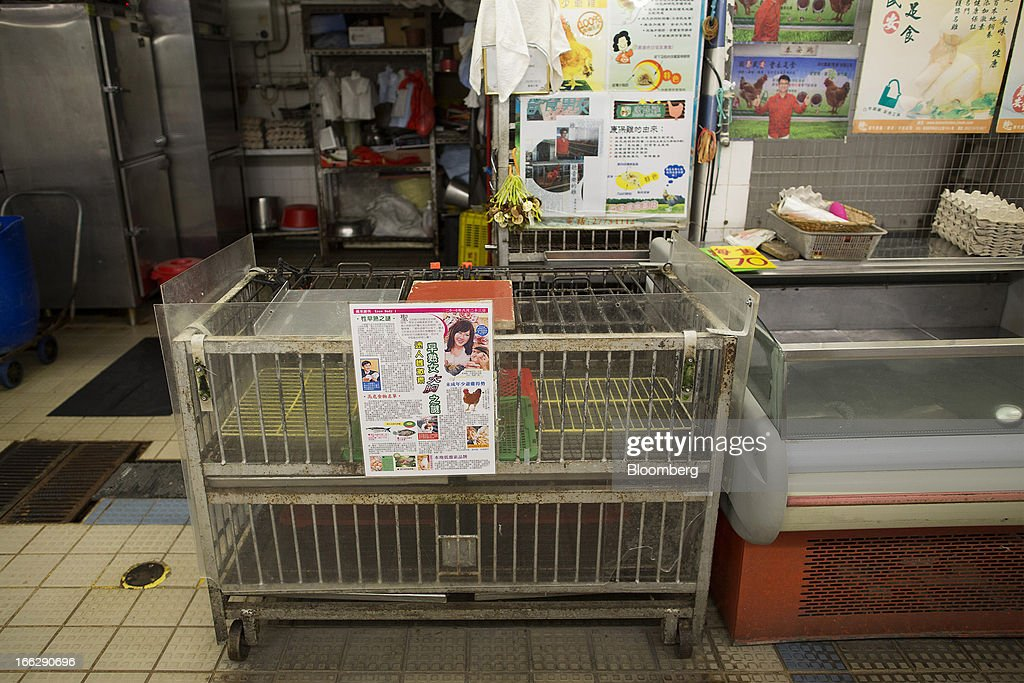 A chicken cage sits empty early in the morning at the Kowloon City Market in Hong Kong, China, on Thursday, April 11, 2013. The Hang Seng Index rose 0.8 percent to 22,220.65 as of 1:14 p.m. in Hong Kong, headed for its longest winning streak since March 27. The gauge is close to erasing last week's loss prompted by the outbreak of a new strain of bird flu in China. Photographer: Jerome Favre/Bloomberg via Getty Images