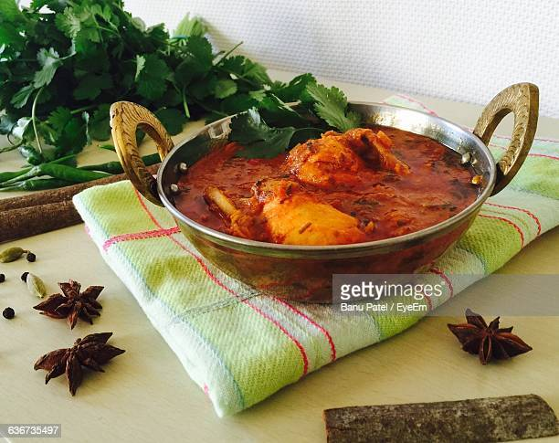 Chicken Curry And Spices On Table