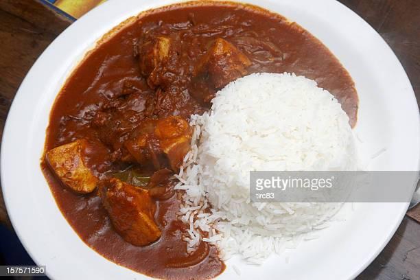 Pollo al curry con riso bollite