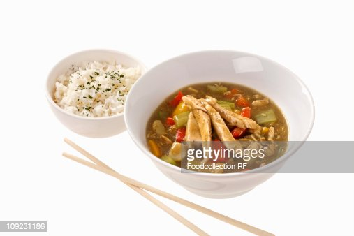 Chicken curry with rice in bowls, close-up : Stock Photo