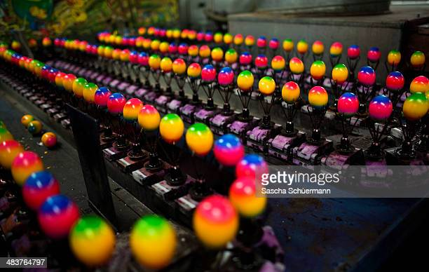 Chicken eggs are coloured for Easter at Baumeister Frischei egg and chicken farm on April 10 2014 in Breckerfeld Germany The farm is among the...