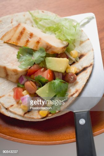 Chicken fajita with chicken and salsa on spatula, close up : Stock Photo