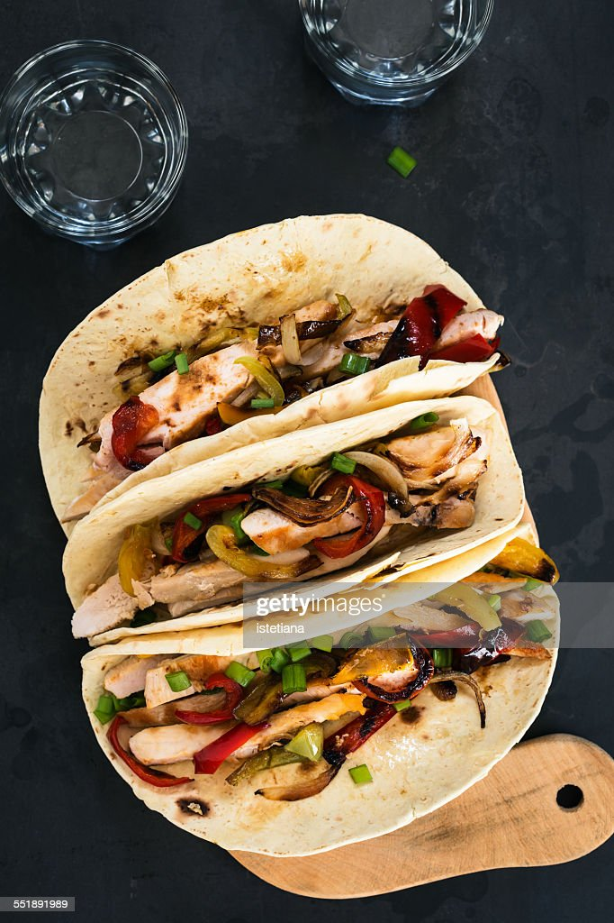 Chicken fajitas served  on a flour tortilla