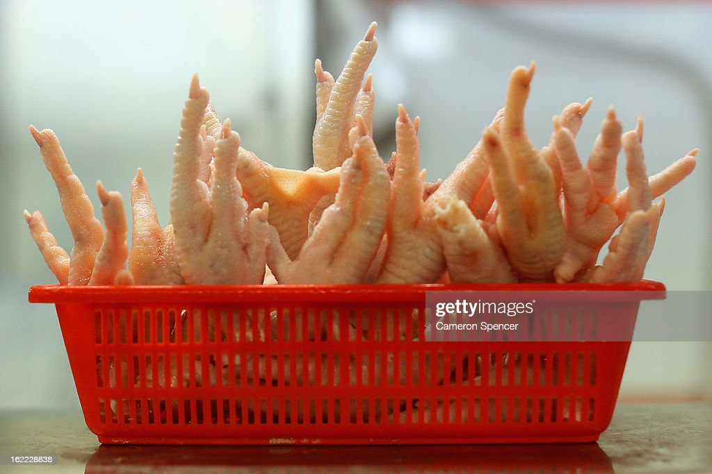 Chicken feet are displayed for sale at the Singapore Chinatown Complex Wet Market on February 21, 2013 in Singapore. The Chinatown Complex Wet Market is a traditional Asian food market popular with elder Singaporeans that features fresh seafood, meat, vegetables, Chinese groceries and a variety of exotic delicacies. The bustling complex floors are never dry with melting ice and water used to clean the floors, fish and vegetables spilling through the space, thus earning the name 'Wet Market'. The markets have retained their relevance by guaranteeing freshness and a personal service between stall mongers and loyal customers.