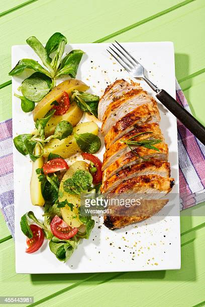 Chicken filet with salad, close up
