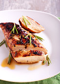 Chicken fillet with mustard and rosemary on plate