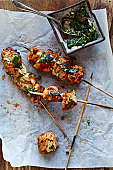 chicken kebabs with salsa on parchment