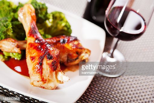 Chicken legs with broccoli : Stock Photo