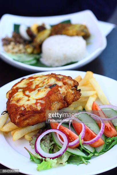 Chicken Parmigiana with chips and fresh salad