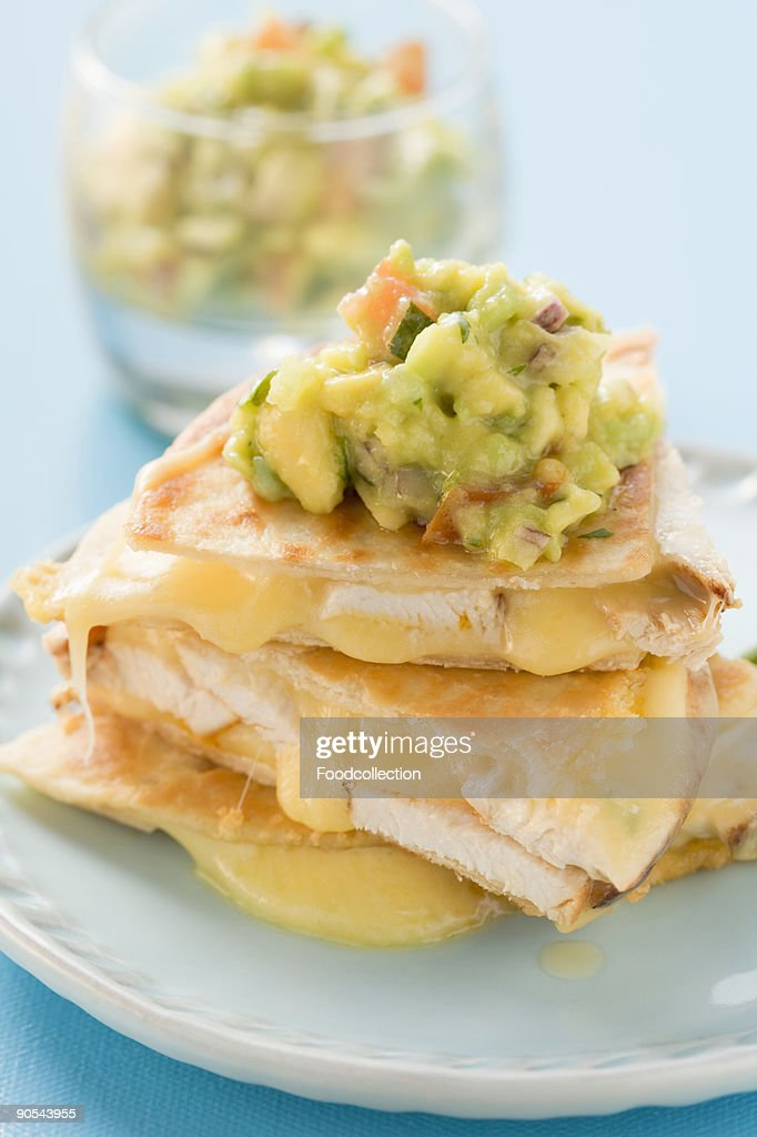 Chicken quesadillas with guacamole, close up : Stock Photo