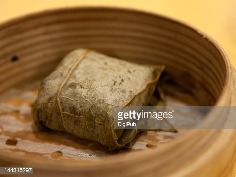 Chicken rice dumpling wrapped in lotus leaf : Stock Photo