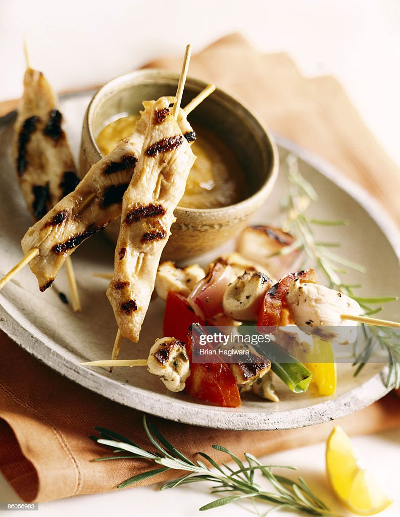 Chicken satay with peanut dipping sauce : Stock Photo