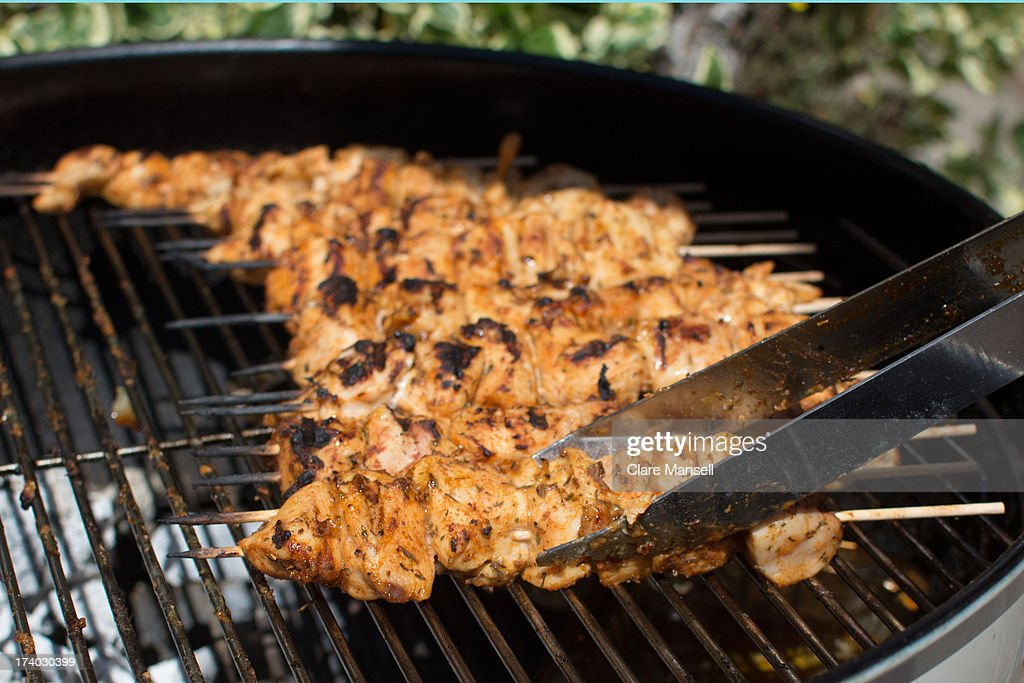 Chicken skewers on a barbecue : Stock Photo