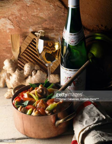 Chicken stew and a bottle and glass of Pinot Gris wine