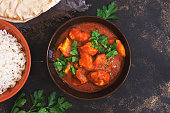 Chicken tikka masala with rice. Asian-Indian dish. Top view, copy space