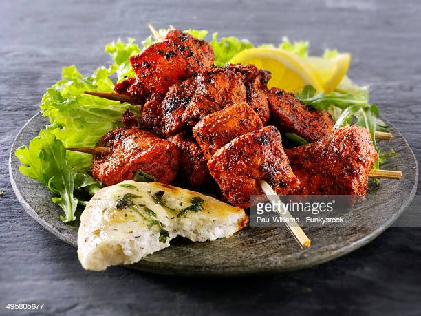 Chicken Tikka with salad and naan bread