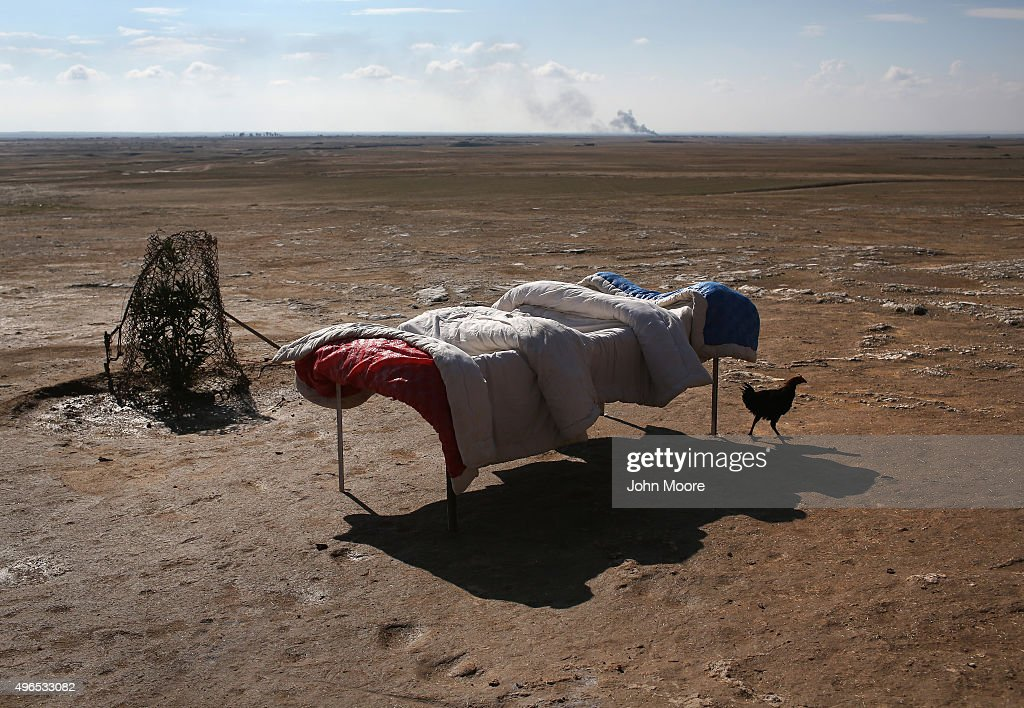 A chicken walks past a bed, airing out after the village was liberated from ISIL on November 10, 2015 near the ISIL-held town of Hole in the autonomous region of Rojava, Syria. A coalition of forces, primarily Kurdish, are attacking ISIL extremists in the area near the Iraqi border and calling in airstrikes from U.S.-led coalition warplanes. The autonomous region of Rojava in northern Syria has become a bulwark against the Islamic State. The Rojava armed forces, with the aid of U.S. airstrikes and weapons, are retaking territory which had earlier been captured much by ISIL from the Syrian regime.