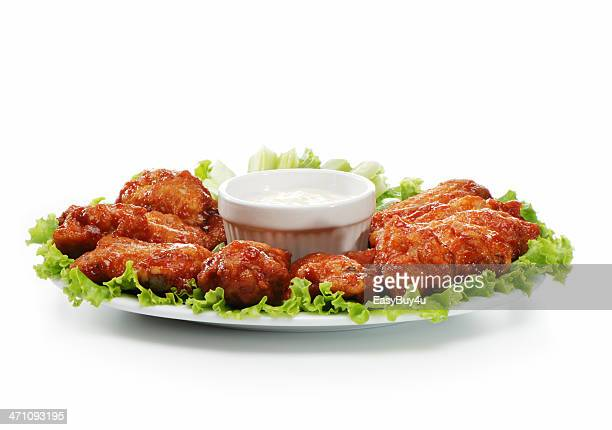 Chicken wings served on a plate with a dip
