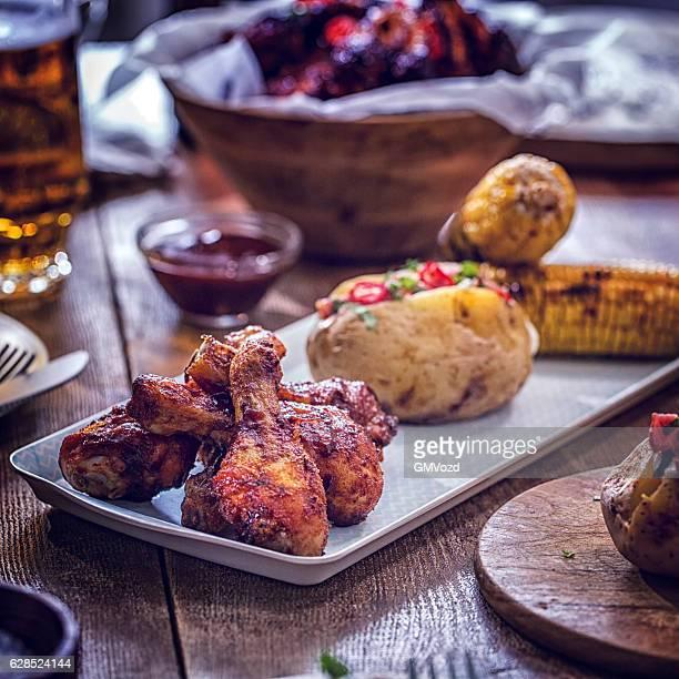 Chicken Wings with Baked Potato and Corn