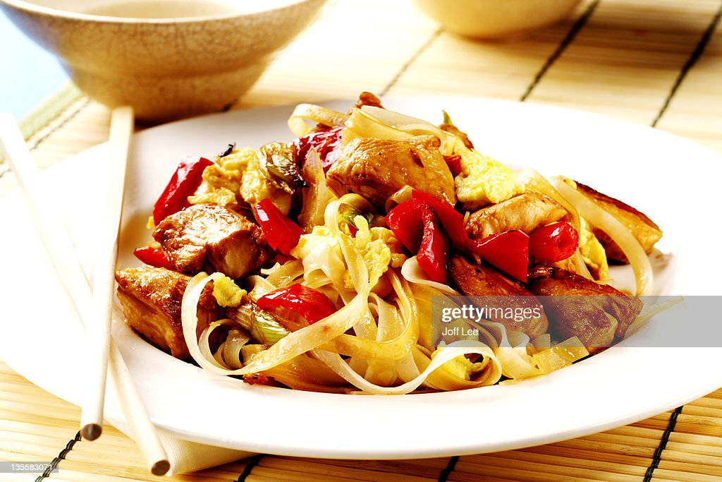 Chicken with noodles and red pepper : Stock Photo