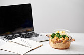 Chicken with soy sauce and a rice and a laptop for work