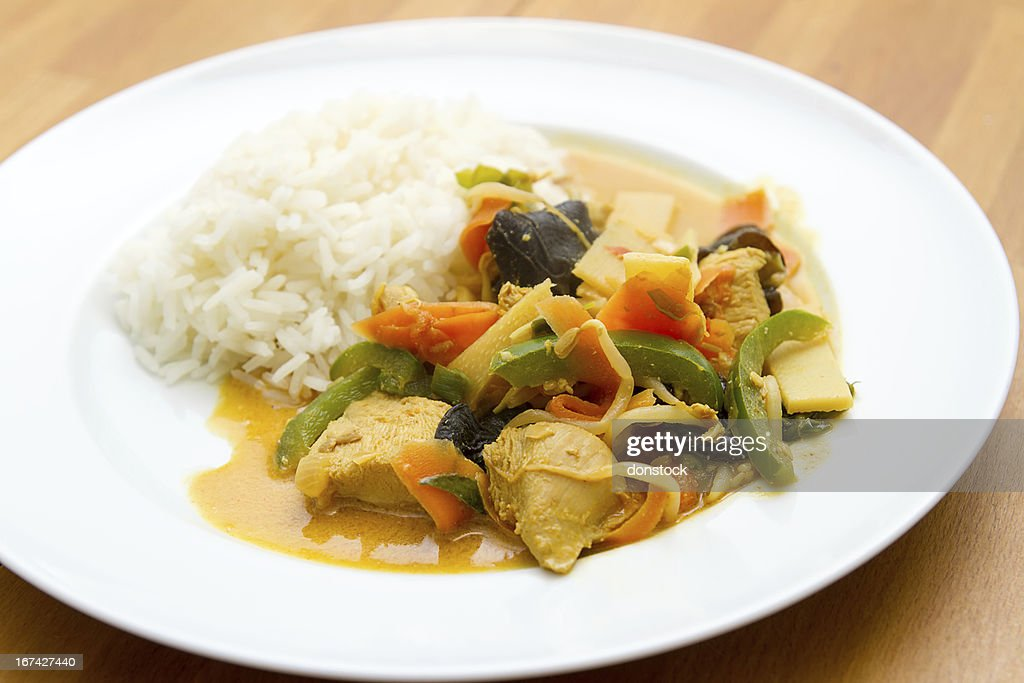 Chicken with vegetables and rice : Stock Photo