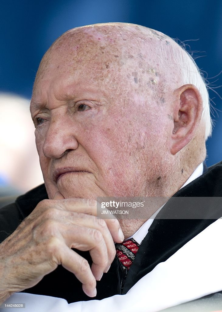 ChickfilA founder and Chairman STruett Cathy listens during the keynote address delivered by US Republican presidential hopeful Mitt Romney at...