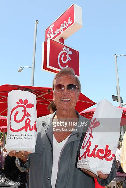 ChickfilA supporter recording artist Pat Boone attends the PETA and the LGBT community's 'ChickfilA Is AntiGay' protest at ChickfilA on August 1 2012...