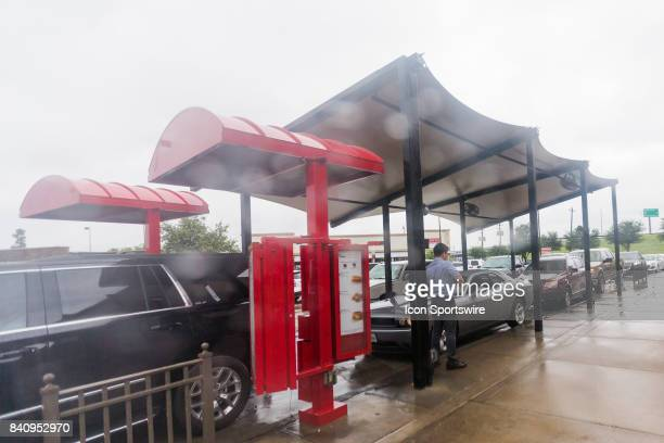 Chickfila workers taking orders for customers lined up around the restaurant during Hurricane Harvey Monday August 29 2017