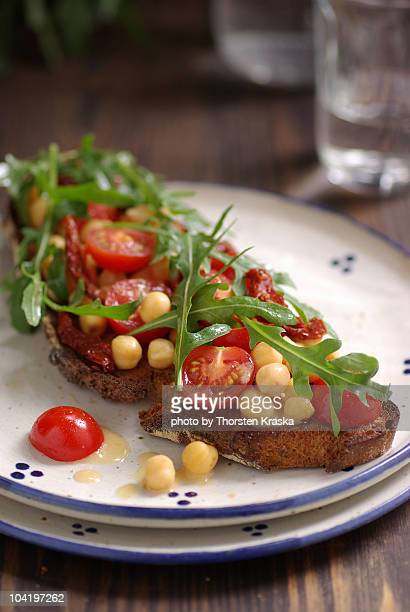 Chickpea and tomato salad on toasted bread