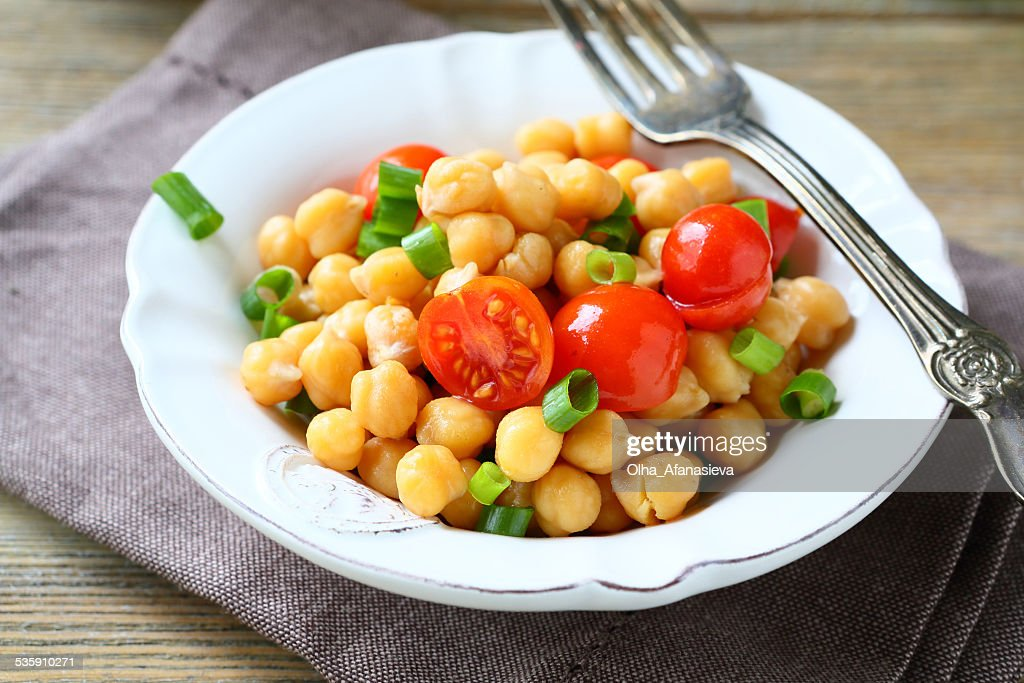 Chickpeas with tomatoes and onions : Stock Photo