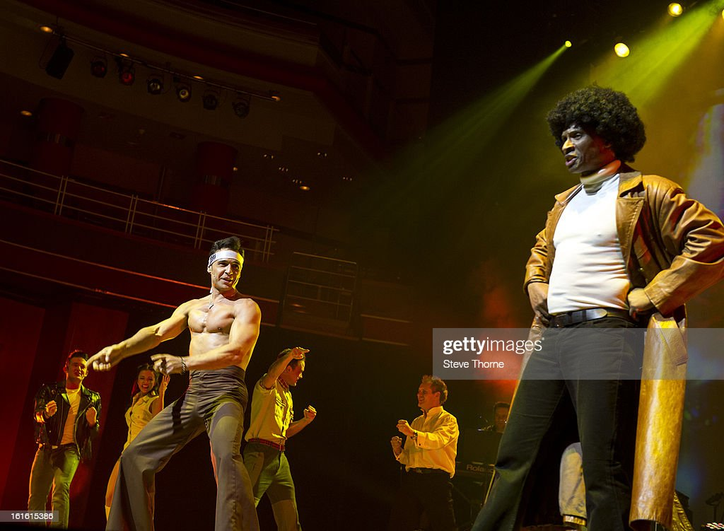 Chico and <a gi-track='captionPersonalityLinkClicked' href=/galleries/search?phrase=Andy+Abraham&family=editorial&specificpeople=666618 ng-click='$event.stopPropagation()'>Andy Abraham</a> perform on stage as part of Boogie Nights at Symphony Hall on February 9, 2013 in Birmingham, England.