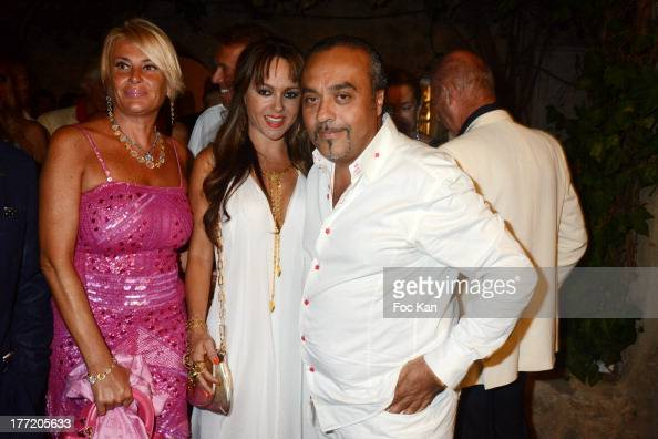Chico Bouchikhi and two guests attend the Massimo Gargia's Birthday Dinner at Moulins de Ramatuelle on August 21 2013 in Saint Tropez France