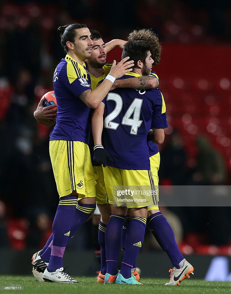 Chico Flores and Alejandro Pozuelo of Swansea City celebrate after their second goal during the FA Cup Third Round match between Manchester United...
