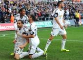 Chico Flores celebrates his goal for Swansea City with Jonathan de Guzman and Alvaro Vazquez during the Barclays Premier League match between Swansea...